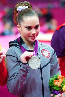 U.S. gymnast McKayla Maroney poses with her silver medal from the London Olympics women's gymnastics vault event finals.