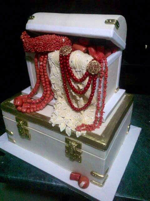 Nigerian bridal trunk cake with coral beads, and lace fabric                                                                                                                                                                                 More