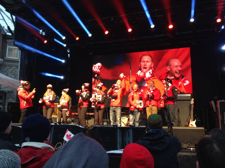 The Canadian men's and women's Olympic curling teams on stage in Banff