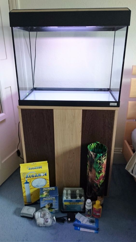 Best 25 fish tank cabinets ideas on pinterest tank for Cheap big fish tanks