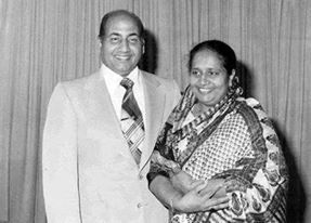 "Mohammed Rafi cheerfully smiling along with his wife Bilquis Rafi.  ""Rafi saab had been singing from the age of 10 So when we got married, he was well into singing ghazals (which were a rage at that time), and film songs. But since I came from a very conservative upbringing, I didn't switch on the radio to hear the music. l was told about his singing, but since I didn't quite like music, it didn't matter so much to me. Even when we were married, Rafi saab didn't encourage me to listen to his…"
