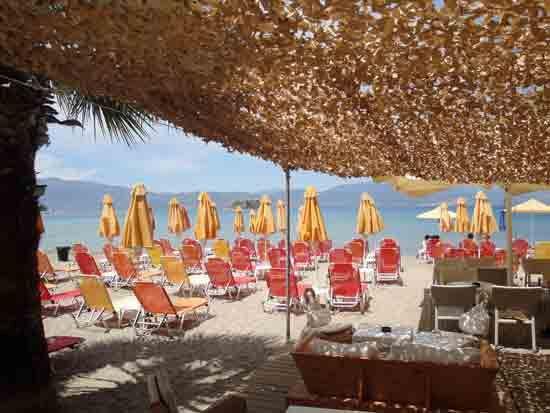 Beach chairs and parasols at Blue Sky Beach Bar, Karathona Beach - Napflio, Greece