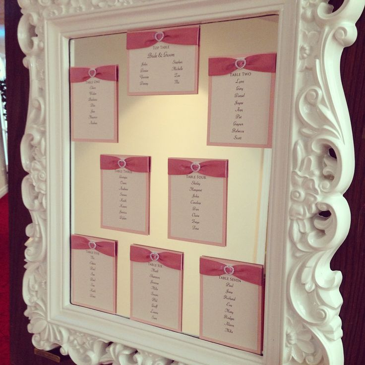 Mirror table plan in dusky pink and ivory finished with pearl heart embellishments.