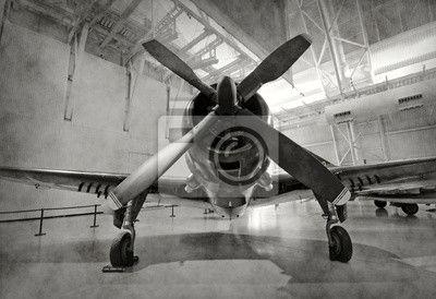 Fotobehang Oud vliegtuig in een hangar