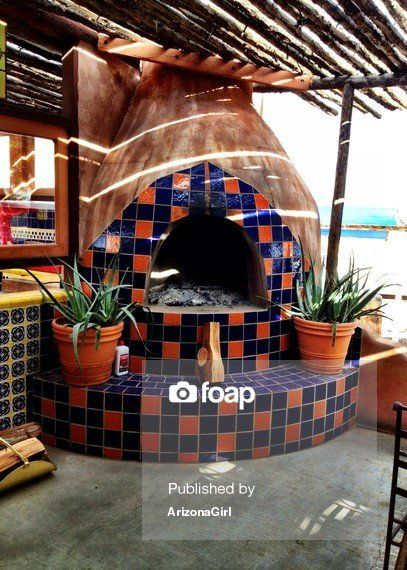 Southwestern Outdoor Fireplace with Mexican Tile Cobalt Blue and Orange | Commercial Use Royalty Free Stock Photography