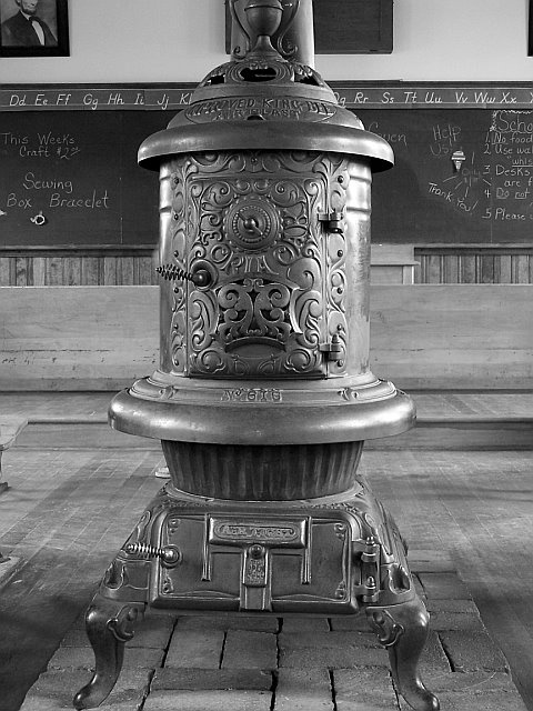 A potbelly stove we used 2 of this to heat our home when I was a kid