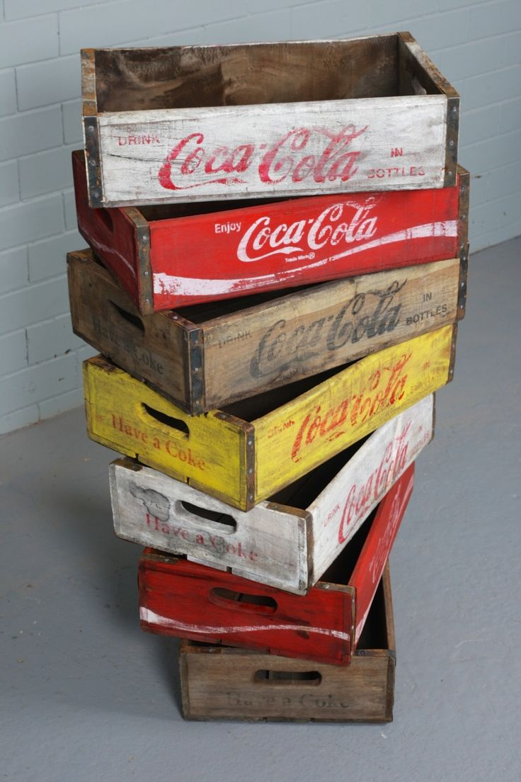 Iconic vintage American Coca Cola crates - wooden with a metal trim.  Perfect for storage
