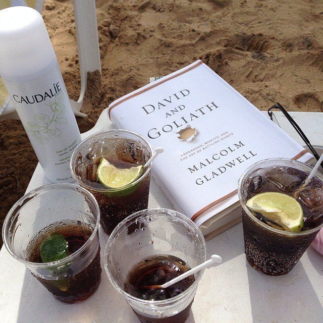 """Pin for Later: Dive In to Our Summer Reads on Instagram  Flygirl777s captioned this beachy setup, """"Only the essentials."""""""