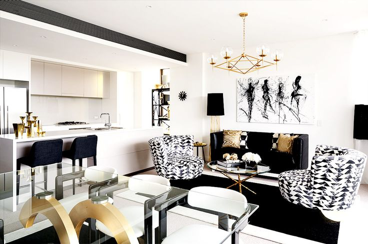 Black, white, and gold living room with bold prints
