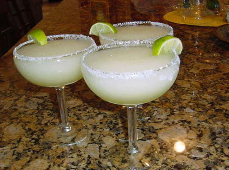 THE ULTIMATE MARGARITA***1	shot of bols brand triple sec (1 ounce)** 1/3	cup of contreau** 2/3	cup of jose quervo brand of tequila** about 2 cups of mr. and mrs. t's brand of sweet and sour mix** ice** 1	lime sliced** blend in blender
