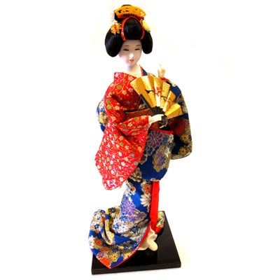 Geisha Doll with Fan - Lovely ceramic Japanese Geisha doll is dressed in a striking red and royal blue kimono.  A great gift for the doll collector!
