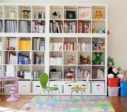 Love it.  A whole wall of storage!!  stacked Expedits (IKEA)