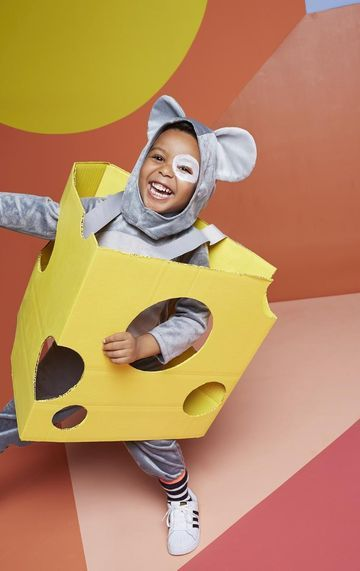 Add a basic cardboard container to a store-bought getup for a one-of-a-kind costume, like this Big Cheese Halloween costume.