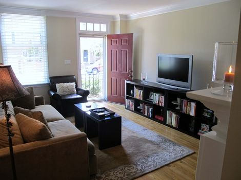 Ikea expedit shelving unit as a tv stand living room for Tv stand for small living room