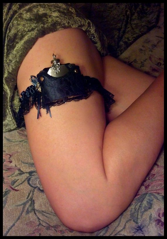 Padded holster is done to resemble corset / negligee with low neckline, shoulder straps that hold flask in place and brass pin strapping in ...