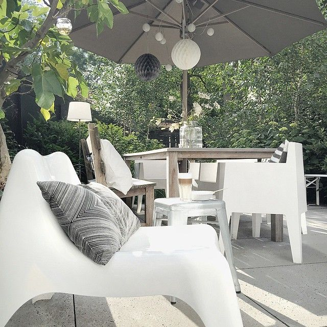 Lounge chair under pergola