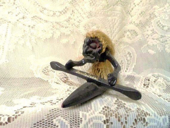 BONITA BEACH Figural Souvenir- Travel Souvenir- Carved Wood Tribal Figure in Canoe-Long Hair- Man Rowing Kyak by OrphanedTreasure on Etsy