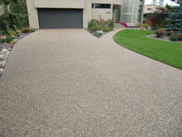 Exposed Aggregate Driveways, Patios and Walkways: An Inspiration Gallery Exposed aggregate concrete can almost be compared to a piece of granite or marble transformed by polishing: A plain, unremarkable surface has... READ MORE HERE:http://hmlconstruction.ca/blog/2016/07/06/exposed-aggregate-driveways-walkways-patios/ P: 780.460.2088 E. info@hmlconstruction.com www.hmlconstruction.com #HMLlandscape