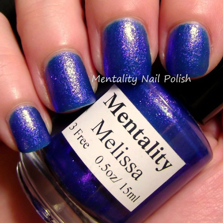 Mentality Nail Polish - Melissa is a super dense blue glass fleck nail polish with a purple flash. This polish dries to a textured finish. For a smooth finish, use top coat.