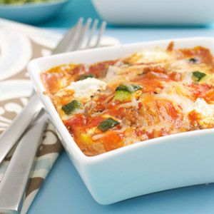For this 30 minute dinner, the polenta, meat sauce and cheese are layered into individual casserole dishes so each person gets their own mini lasagna.