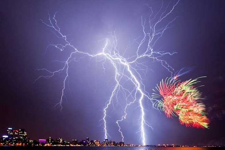 Genuine picture of lightening spicing up a fireworks show in Perth, Australia. 2012