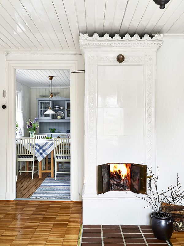 my scandinavian home: swedish cottage. Love this website and this wood burning stove!