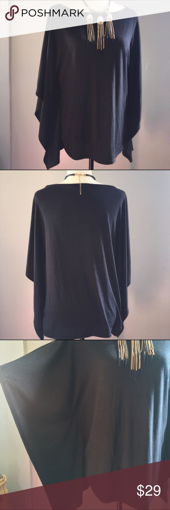 Black Batwing Top In excellent condition. Fast shipping. No trades. Size says xs but fits my medium dress form perfectly. Thank you for shopping my closet! Trouve Tops