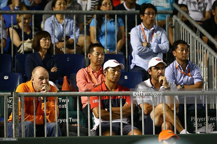 Kei Nishikori of Japan is watched in action against Roberto Bautista Agut of…