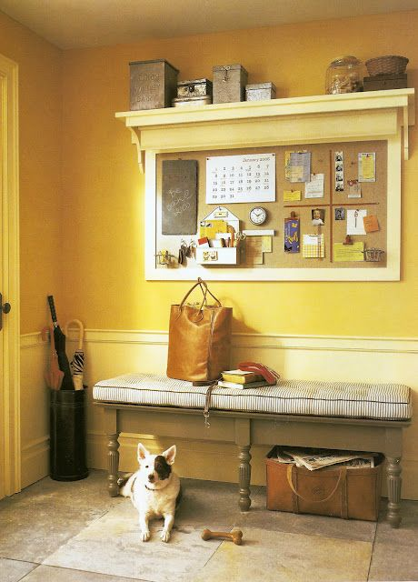I like the shelf idea. mirror instead of cork board, then a small shelf with hooks under...(Entryway solutions from the pages of Martha Stewart Living.)