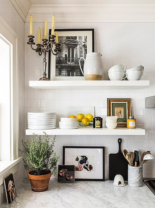 Open shelving creates an airy vibe and shows off Michelle's clean white dinnerware and personal accessories.