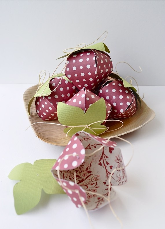 So Cute. Strawberry favor boxes. This isn't a how-to link but the photo provides a good look at them. They wouldn't be too difficult to make.