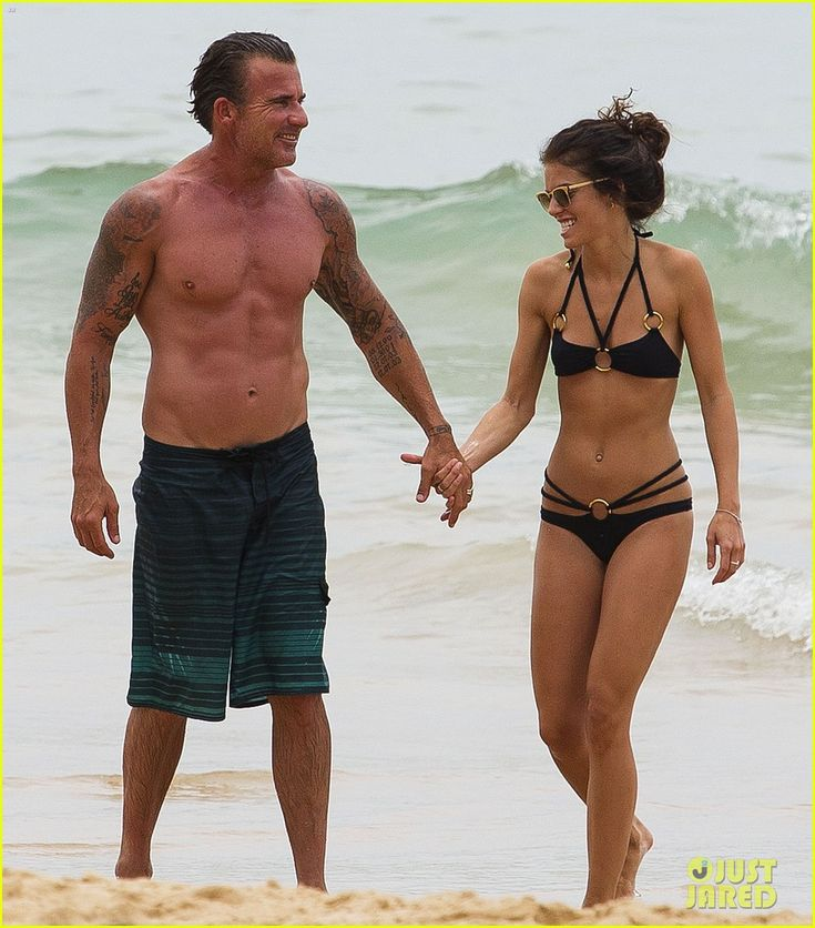Annalynne Mccord And Dominic Purcell Hold Hands And Show