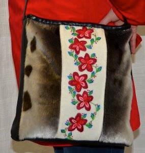 Inuit made embroidered sealskin purse by Eva Sakiagak Audlaluk