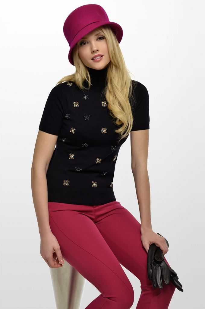 Sarah Lawrence - collar neck embellished sweater with stones, skinny pant.