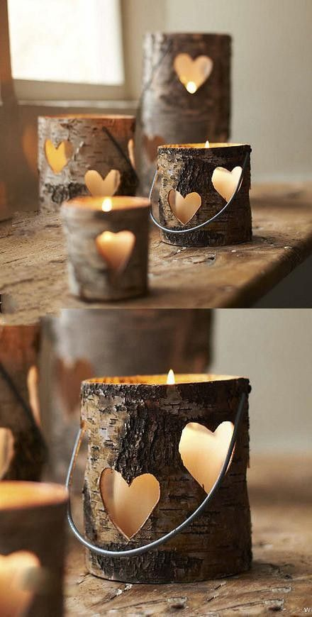 Heart-shaped hollow wood piles small candle lights.
