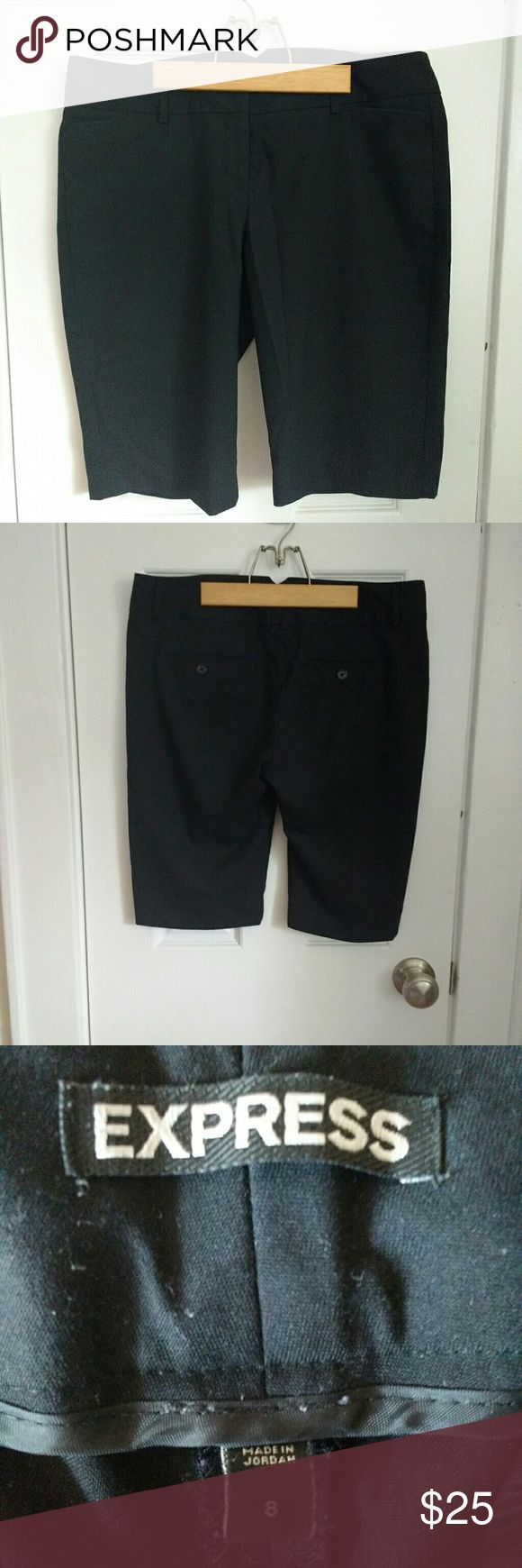 Express bermuda short Black shorts, length to right above the knee (approx 20 inches long) Fit and material are exactly like traditional business slacks - 64% polyester, 34% viscose rayon, 2% elastine. Machine washable. Worn 2 or 3 times, no wear, like new Express Shorts Bermudas