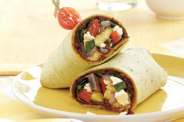Grilled Vegetable and Feta Wraps - Grilling the vegetables takes little time and yields the great flavour that goes into these veggie-filled wraps. When it's not grilling season, spread the vegetables on a baking sheet and broil them for the same amount of time as you would grill them.