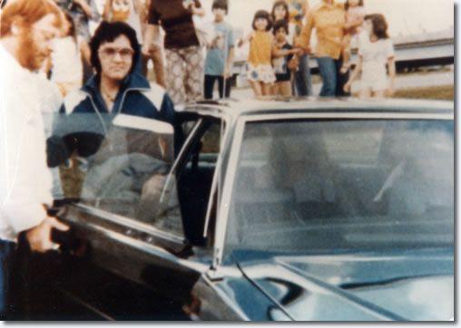 Elvis Presley leaving his hotel in Shreveport, LA on his way to Baton Rouge, LA on July 2, 1976.