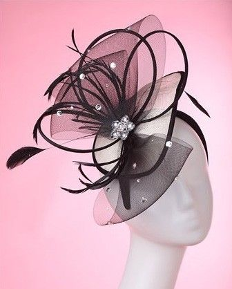 """""""Angela"""" White and Black FascinatorPerfect for Derby Day! The 'Angela' carries a definite wow factor. Sitting atop a satin black headband, the scooped sinamay base features a stunning sinaway arrangement of feathers, sinamay bows and crystals finished in the centre with a jeweled masterpiece. $79.95 including gift box and FREE shipping in Australia."""