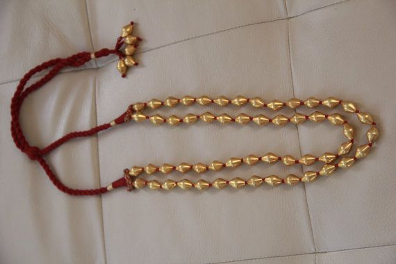 Necklace of double lined gold-plated dholki beads in 92.5 pure