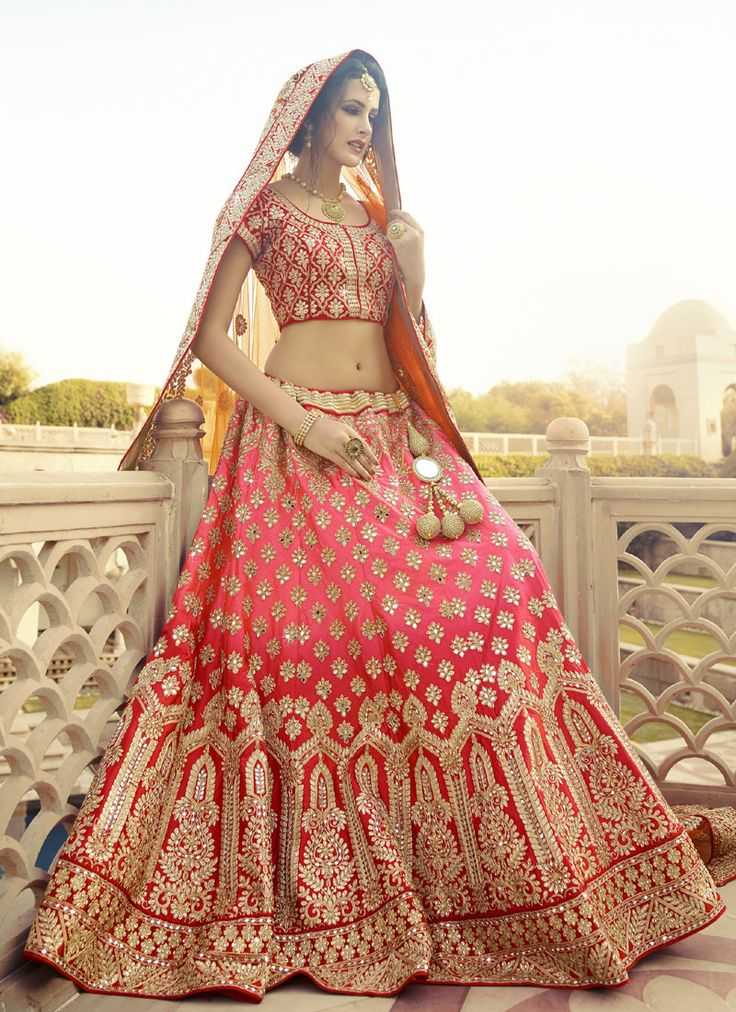 This delightful diva accoutre features unique styling material. Spread the aura of freshness with this pink and red art silk, net and velvet a line lehenga choli showing a touch of sensuality. This beautiful attire is showing some amazing embroidery done with embroidered and patch border work. Comes with matching choli and dupatta. (slight variation in color, fabric & work is possible. Model images are only representative.) #LehengaCholiStore #LehengaCholiUK #LehengaCholiUSA #LehengaCholi