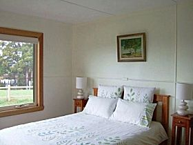 A delightful quiet rural spot surrounded by native forest and rolling pasture with sweeping picturesque views towards the distant shimmering sea for you to enjoy when you stay in this accommodation in Tasmania. #AccommodationTasmania www.OzeHols.com.au/96