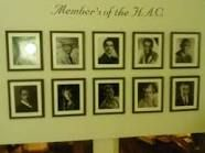 photo wall of famous members in back hallway of HAC