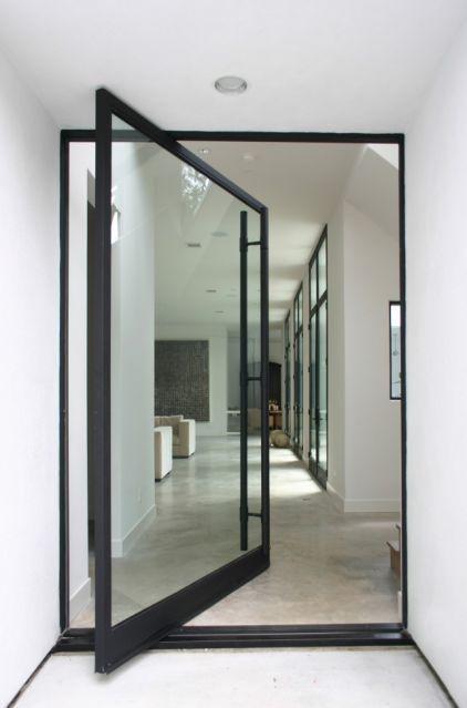 framed glass pivot front door