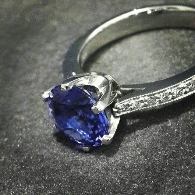The deep blue of the tanzanite is fantastic, and runs from ultramarine blue to light violet-blue.  This violet-blue 2.74ct Round Cut Tanzanite in a Handcrafted Diamond and Platinum Ring.   Africn - Tanzanite - Diamonds - Platinum