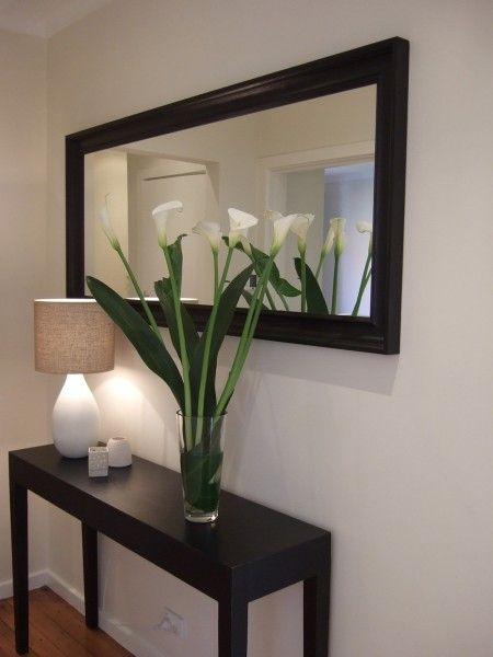 Hampton simple but elegant entry adorned with lilies.