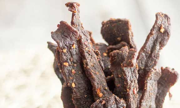 You can add jerky to your list of Paleo snacks, as it's mostly meat, but you'll want to make sure to make it yourself so that you can have the final say over what goes in it. With the leading jerky manufacturer using things like mechanically separated chicken, MSG, and enough sodium to bring...