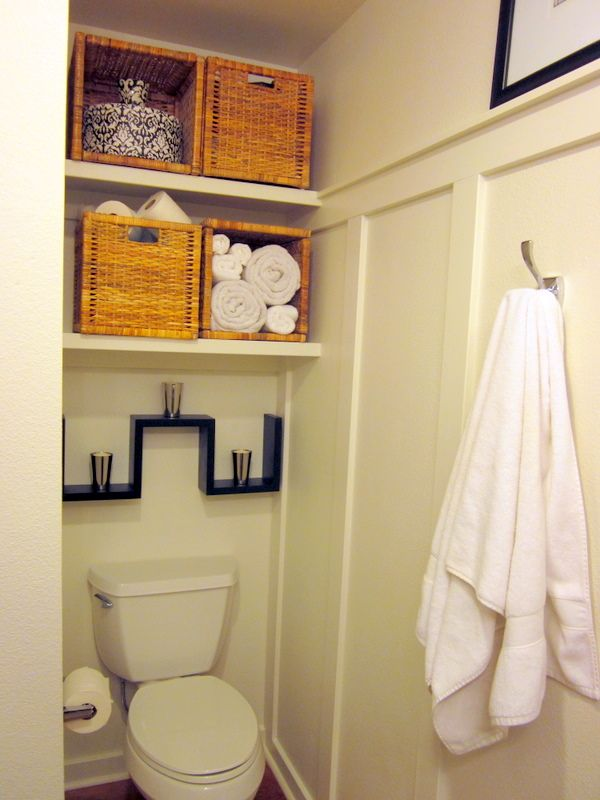We had a big, unused, open space over the toilet between 2 walls. We needed as much storage as we could get.  So, good husband built me (more eye batting) 2 shelves to store necessities in nice baskets. This space could be covered with doors at a later date. The shower is just to the left of the wall.