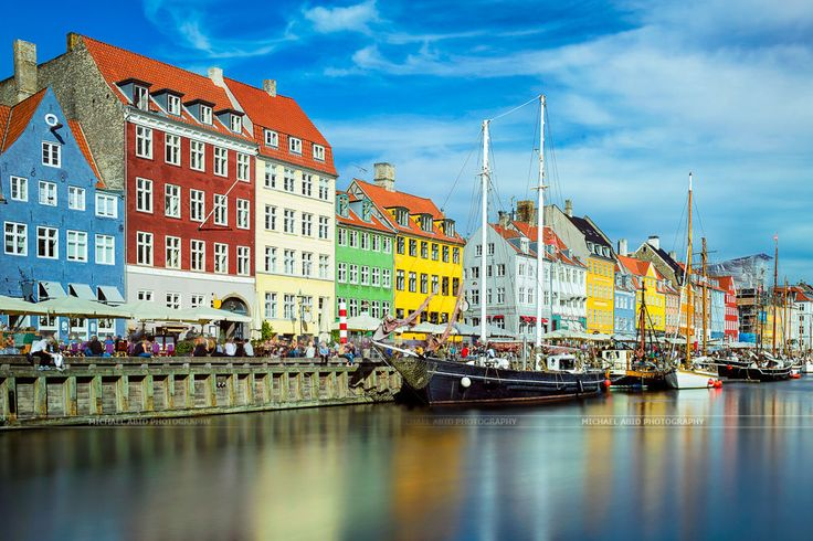 Nyhavn in Copenhagen, Denmark on a sunny day in September 2014. Contrary to the weather forecast which was predicting rain for the whole day