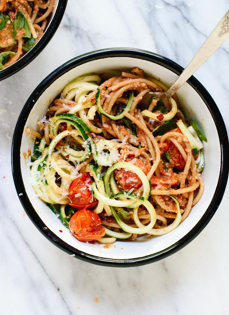 This fresh summer recipe features burst cherry tomatoes, cherry tomato and sun-dried tomato pesto, zucchini noodles and spaghetti! It's light and delicious.